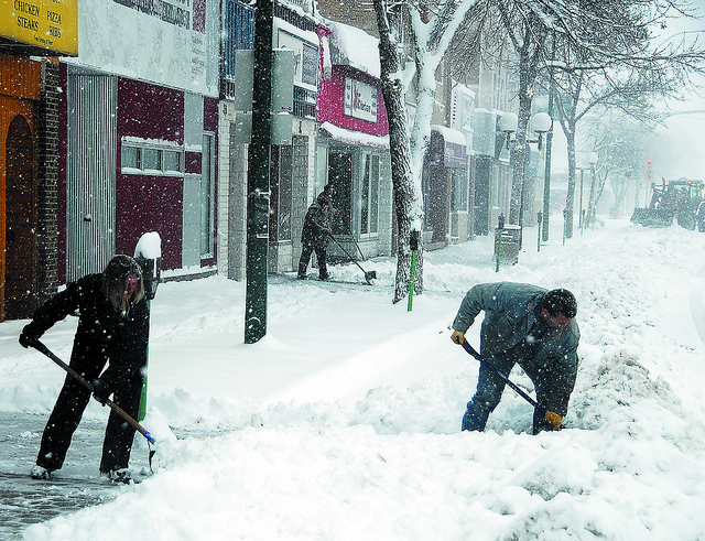 people shoveling snow by Flickr user Rob Swystun