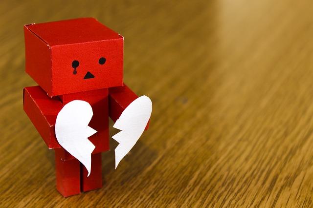 sad robot with broken heart