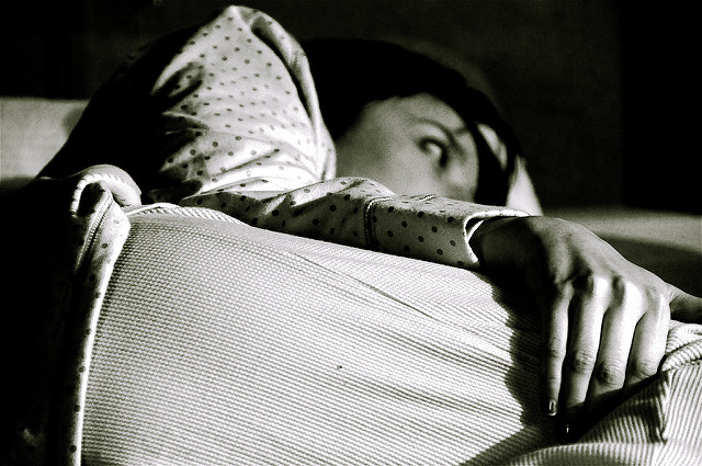 woman with insomnia by Flickr user Alyssa L Miller