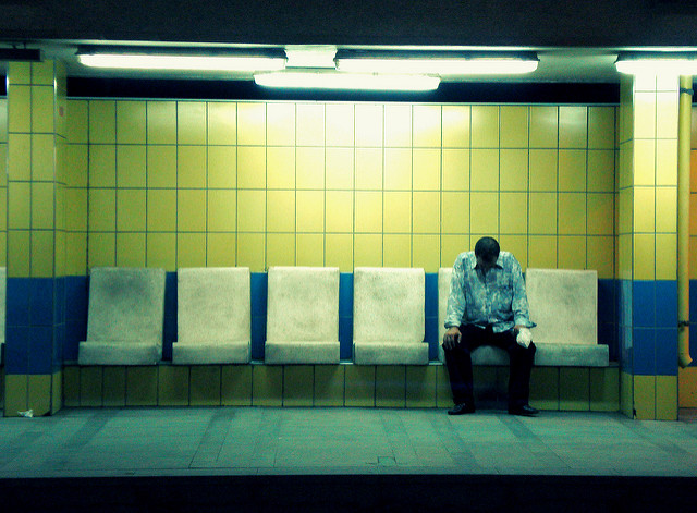 stressed man on bench by Flickr user rana ossama