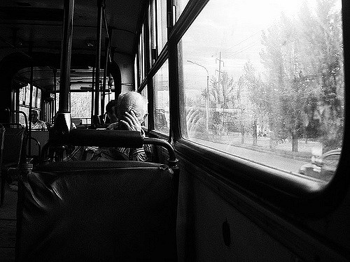 tired man on bus by Flickr user Zaytsev Artem