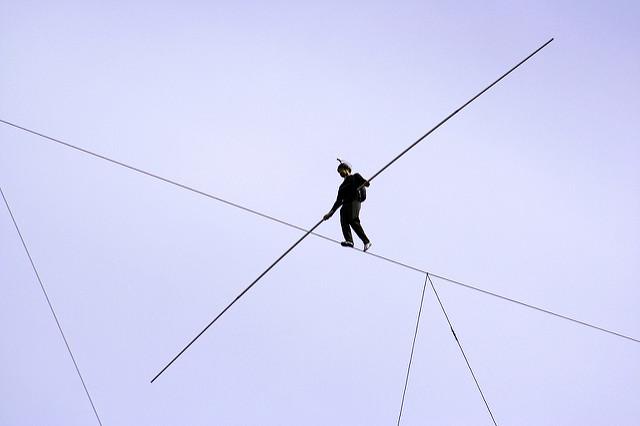 tightrope walker by Flickr user Graeme Maclean