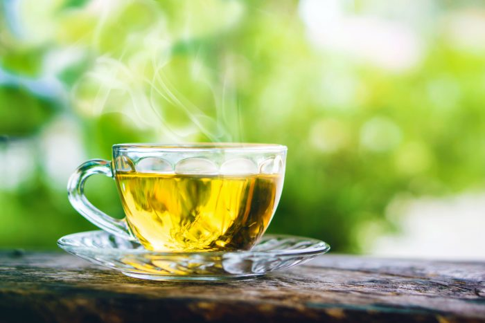 Steaming cup of green tea