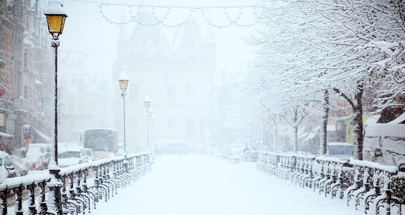 snowy blizzard street with lamp posts