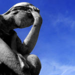 statue with headache by Flickr user threephin