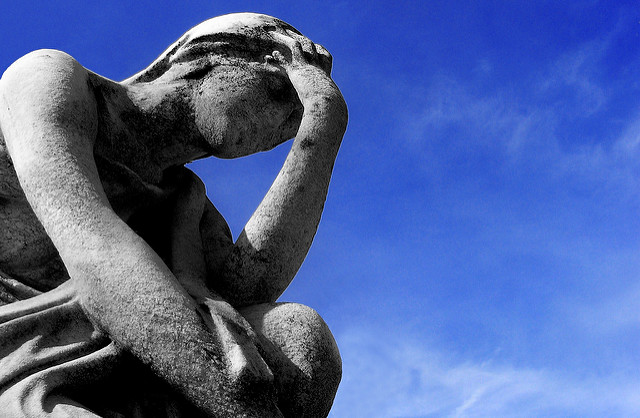 statue with headache by Flickr user threephin